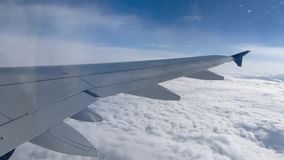Clouds viewed through the window of an airplane stock video footage