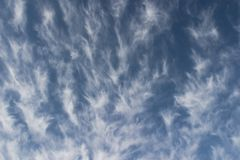 Clouds wallpaper. Blue winter sky with high altitude clouds Stock Photo