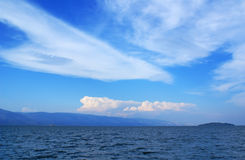 Clouds and water. Wonderful clouds, blue sky, lake Baikal Royalty Free Stock Photography