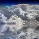 Clouds and water. Kind on clouds on a background and their reflections in water stock photo