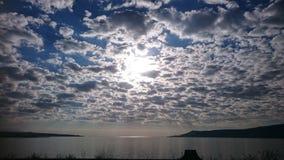 Clouds and water sun Stock Photos