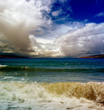 Clouds and waves Royalty Free Stock Photos
