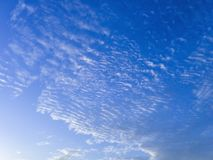Clouds were floating across the blue sky. Stock Photography