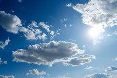 Clouds white blue sky fluffy windy weather daylight sunny. Bright royalty free stock image