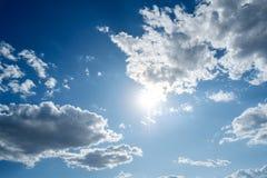 Clouds white blue sky fluffy windy weather daylight sunny. Bright stock photo
