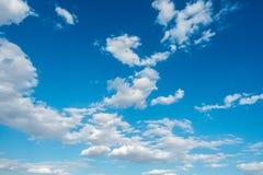 Clouds white blue sky fluffy windy weather daylight sunny. Bright royalty free stock photo