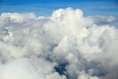 Clouds. White clouds in the blue sky, a photo with the airplane, god, life Stock Photography