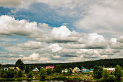 Clouds. White clouds are floating above the village royalty free stock images