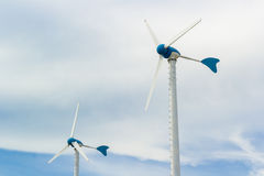 Clouds with wind turbine Stock Image