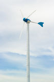 Clouds with wind turbine Stock Photo