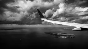 Clouds and wing outside the window in a aircraft royalty free stock photos