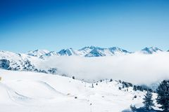 Clouds at Zillertal Arena ski resort in Austria. Clouds at Zillertal Arena ski resort in Zillertal in Tyrol. Mayrhofen in Austria in winter, in Alps. Alpine royalty free stock images
