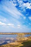 cloudscape πεδίο που πλημμυρίζου& Στοκ Φωτογραφίες