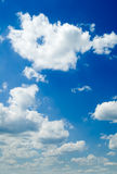 Cloudscape. White clouds in the blue sky Stock Photography