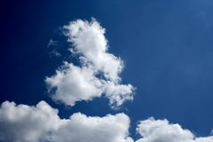 Cloudscape 3. Dark blue sky with white clouds 3 Royalty Free Stock Photo