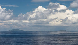 Cloudscape. Dramatic stormclouds over the Seychelles islands in the Indian Ocean during the December monsoon period royalty free stock images
