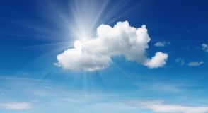 Cloudscape. Blue sky with sun and cloud Royalty Free Stock Image