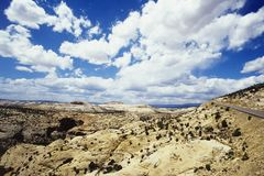 Cloudscape above rocky landscape Royalty Free Stock Images