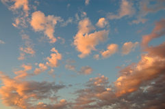 Cloudscape abstrato do por do sol Imagens de Stock