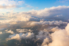 Cloudscape aerial view from airplane window seat Royalty Free Stock Image