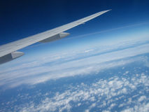 Cloudscape and aircraft wing royalty free stock photos