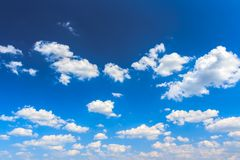 Cloudscape background of vivid blue sky Royalty Free Stock Photos