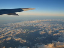 Cloudscape beneath aircraft. Cloudscape beneath wing of aircraft stock photo