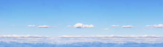 Cloudscape and blue sky. Panoramic view of cloudscape in clear blue sky royalty free stock image