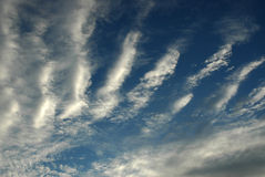 Cloudscape in blue sky. Abstract background of stripey cloudscape formation in blue sky Stock Photo