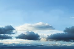 Cloudscape - Blue sky with layers of clouds near the bottom as a storm forms - no land - background or room for text. A Cloudscape - Blue sky with layers of royalty free stock photos