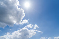 Cloudscape with blue sky and sun Royalty Free Stock Image