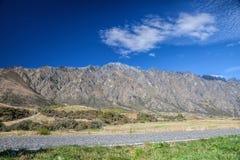 Cloudscape boven berg en groen gebied Royalty-vrije Stock Fotografie