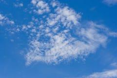 Cloudscape bulding a shape. Blue sky with clouds building a triangular shape Stock Photo