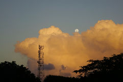 Cloudscape with the crescent moon at sunset Royalty Free Stock Images