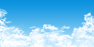 Cloudscape with cumulus clouds on blue sky Stock Image