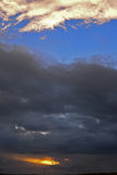Cloudscape with dark clouds Stock Images
