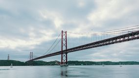 Cloudscape on the 25 de Abril Bridge in Lisbon stock footage