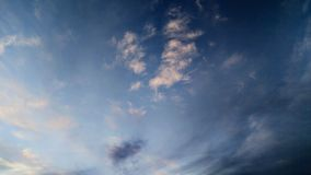 Cloudscape of Black and White. A cloudscape dichotomy of bright white clouds and dark black clouds just before sunset Stock Photo