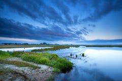 Cloudscape en la salida del sol sobre pantano Fotos de archivo libres de regalías
