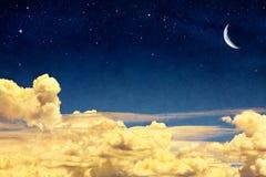 Cloudscape et lune Image libre de droits
