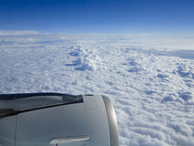 Cloudscape and flight engine Royalty Free Stock Photo
