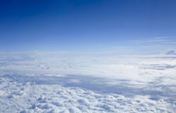 Cloudscape through flight window Royalty Free Stock Photography