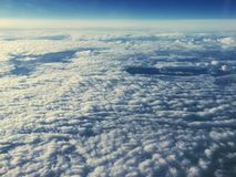 Cloudscape. High altitude view of cloudscape from an airplane Royalty Free Stock Photo