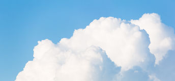 Cloudscape horizontal banner. Or panorama of beautiful fluffy white cumulus clouds in a sunny blue summer sky Royalty Free Stock Photos