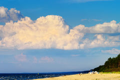 Cloudscape with huge cumulonimbus cloud formation over the beach at Baltic sea. Royalty Free Stock Image