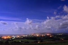 Cloudscape illuminato dalla luna sopra la baia di Sandown Immagine Stock Libera da Diritti