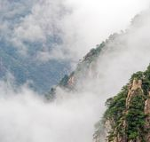 Cloudscape image of Huangshan. (yellow mountain) and pine tree on the top(like avatar). Foggy day, Huang Shan, China stock images