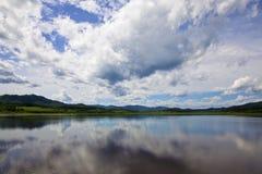 Cloudscape on lake stock image