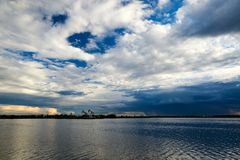 The cloudscape and lake in oil fields. The photo was taken in Daqing oil fields of Daqing city Heilongjiang province, China royalty free stock photography