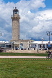 Cloudscape with Lighthouse in Patras, Peloponnese, Greece Stock Photo